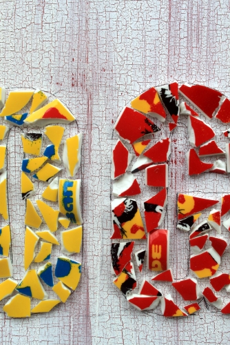 Detail of Incognito artwork. Ceramic mugs on a crackled paint effect.